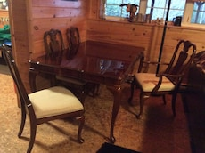 brown wooden rectangular table with chairs