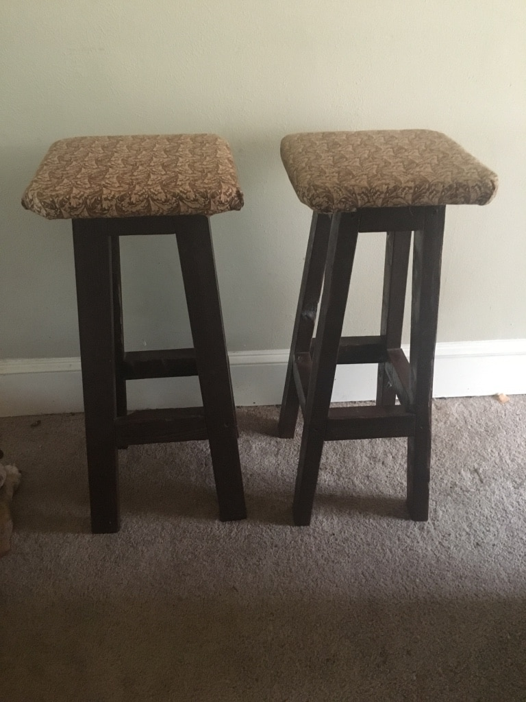Two brown wooden square stools