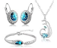 silver and blue gemstone pendant necklace and earr Ahmedabad, 380021