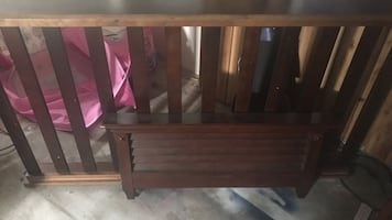Brown wooden twin bed frame, and dresser included.