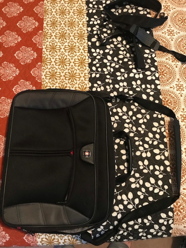 Swissgear laptop bag. Practically new. No rips or tears. Accessories included. Cash only