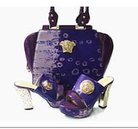 purple Versace handbag and pair of chuky-heeled sandals