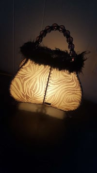 white and brown zebra print table lamp