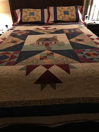 Brown, red, and green tribal bed linen
