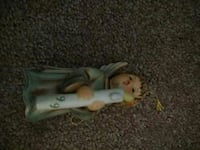 angel child holding candle ceramic figurine