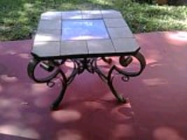 24inch tall ceramic and glass finish table with bronze leg finish.