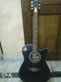 black and brown acoustic guitar 12081 km