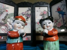 Oriental couple figurines