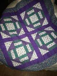 """Small quilt beautifully hand made approximately 36"""" x 36"""". Brilliant purple and green on a pale cream background. Lake Placid, 33852"""