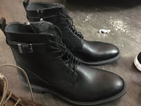 pair of black leather boots Calgary, T3K