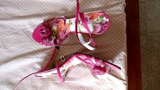 pair of pink-and-white floral open toe sandals