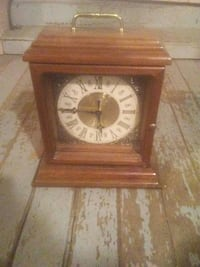 brown wooden analog table clock