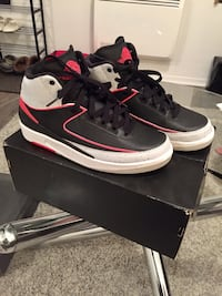 Pair of black-and-red Air Jordan basketball shoes with box