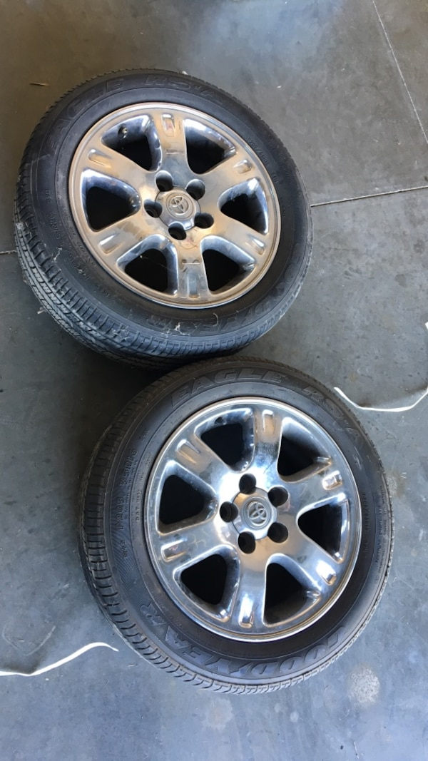 two chrome Toyota 6-spoke car wheel with tire