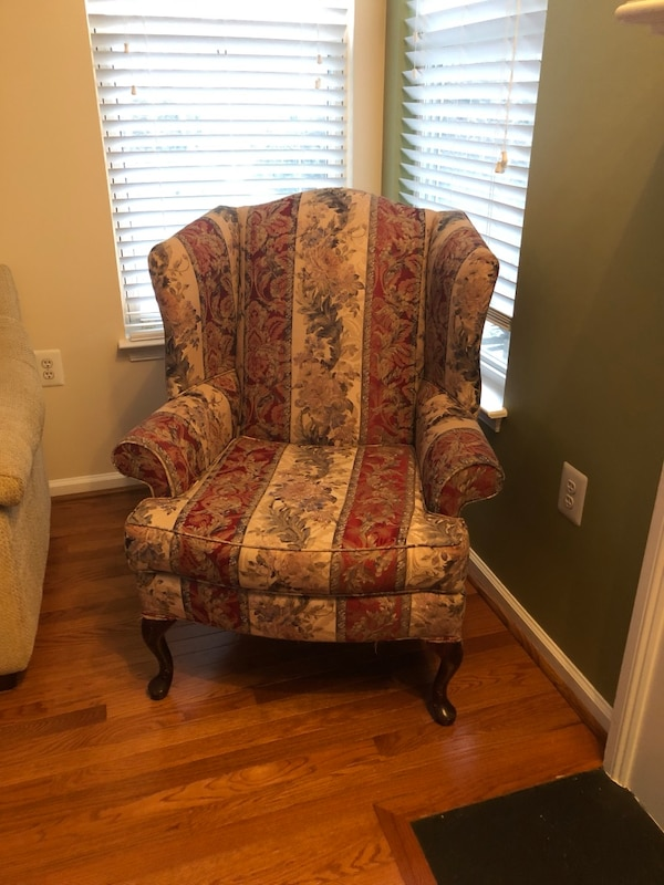 brown and red floral sofa chair
