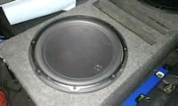 round gray and black subwoofer 1621 mi