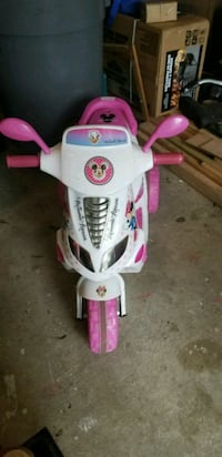 white and pink Minnie Mouse ride-on toy
