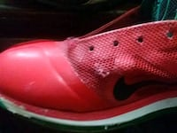 unpaired red Nike low-top sneaker Indianapolis, 46203