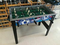 black blue and green foosball table