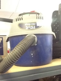blue and white canister vacuum cleaner Hagerstown, 21740