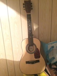 Decent guitar for a kid to learn how to play, comes with extra string
