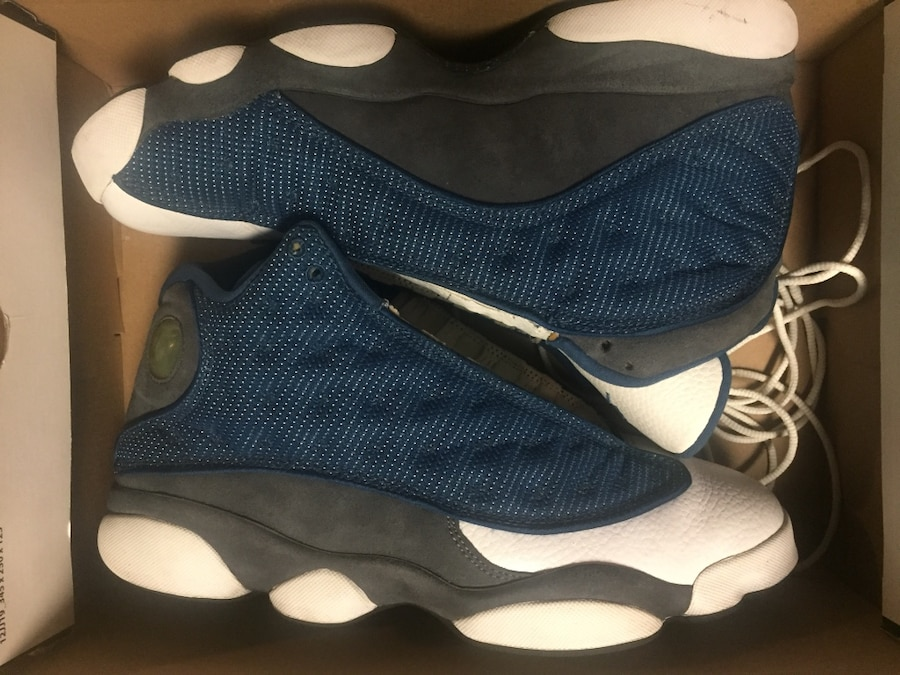 Blue-white-and-black Air Jordan 13 in box