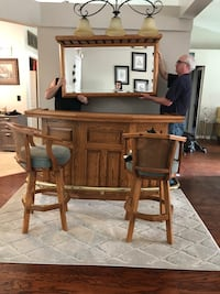 brown wooden desk with chair