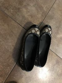 pair of black Coach leather flats 946 mi