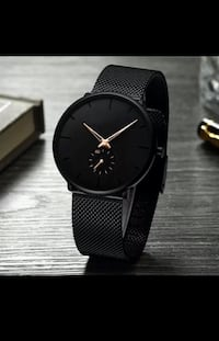 Black stainless steel watch Montréal, H1S 1A4