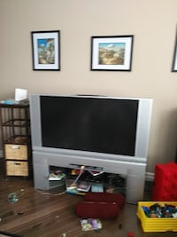gray flat screen television with black TV stand