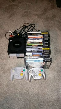 black Nintendo 64 console with controllers and game cases West Linn, 97068