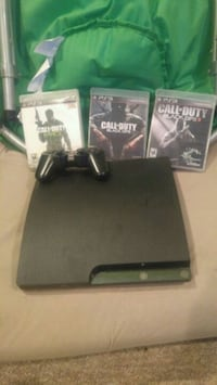 black Sony PS3 slim console with controller and game cases Carrying Place, K0K 1L0