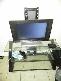 black flat screen tv and stand