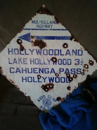 blue and white wooden signage 596 mi