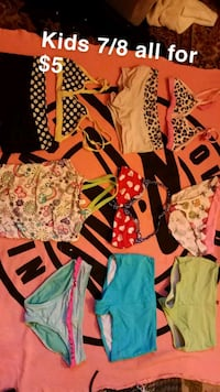 Swimming suits prices and sizes on each picture.