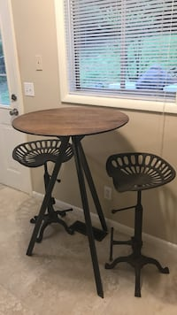 antique iron tractor seats and  reclaimed wood  table