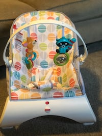Fisher price vibrating bouncer w/removable toy bar Moore, 73160