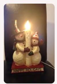 Two snowman and candle figurine