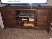 brown wooden TV stand with flat screen television Houston, 77021