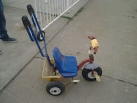 red and blue push trike