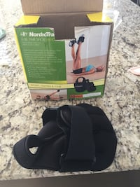 black NordicTrack pair of shoe weights with box