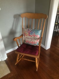 brown wooden framed red and white floral padded armchair