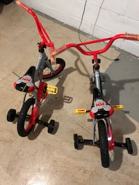 Toddler's red and black bicycle with training wheels Toronto, M9R 2K4