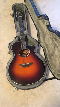 brown acoustic guitar with case Waterdown, L9H 7B8