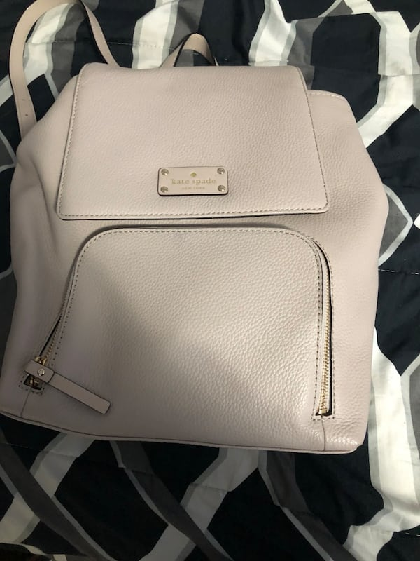 Kate spade backpack , only used once 322b4e6f-4b52-4100-986e-126813d148b8