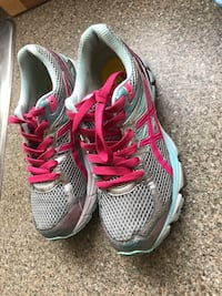 pair of gray-and-pink running shoes