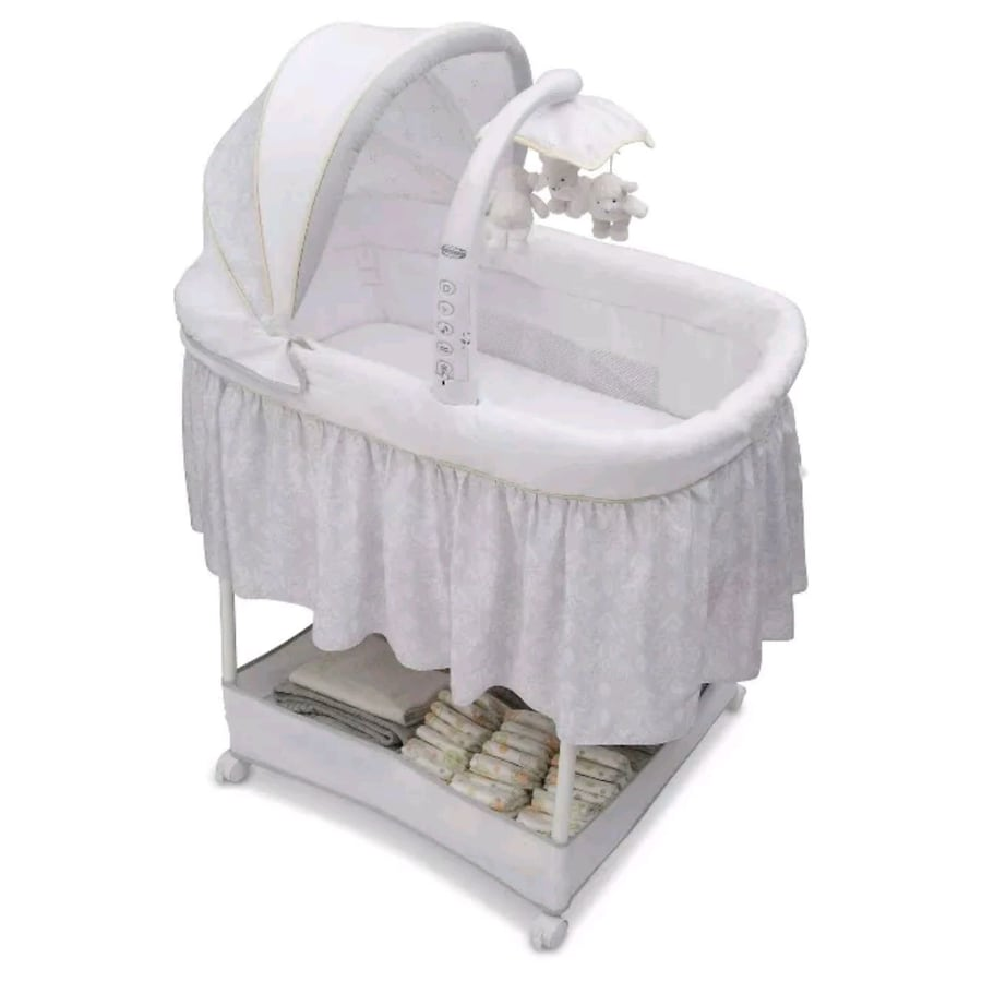 gliding Bassinet with built-in mobile/night light