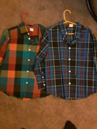 two assorted colored button-up long-sleeved shirts Calgary, T2V 0N2