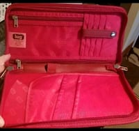 red and black luggage bag 480 km