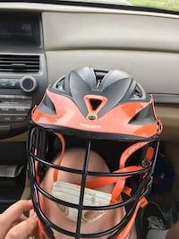 Orange and black lacrosse helmet (Cascade R) Trappe, 21673